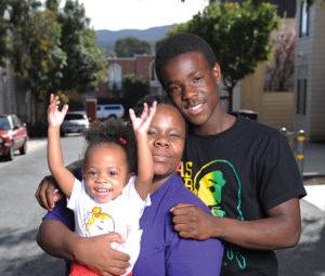 family smiling in residential neighborhood