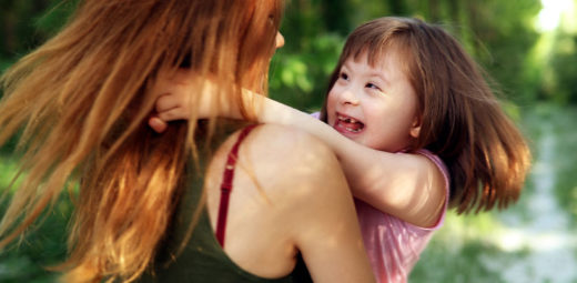 child hugging her mother