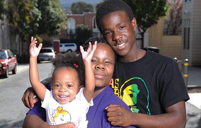 happy family child raising arms