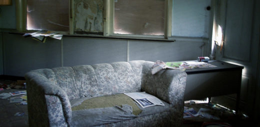 An old couch in an abandoned building