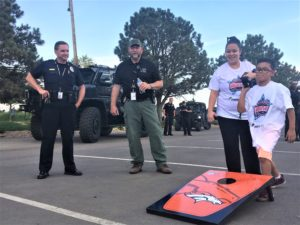 kids playing games and hanging out with firefighters and the police force