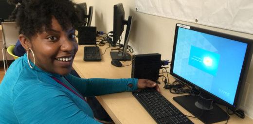 young girl at a computer