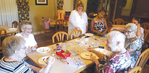 Seniors at Assisi Homes of Kenosha enjoyed working with a volunteer to make their own jewelry.