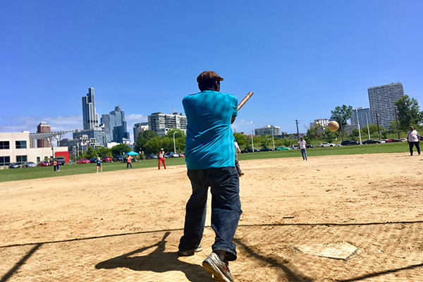 a man hits a softball