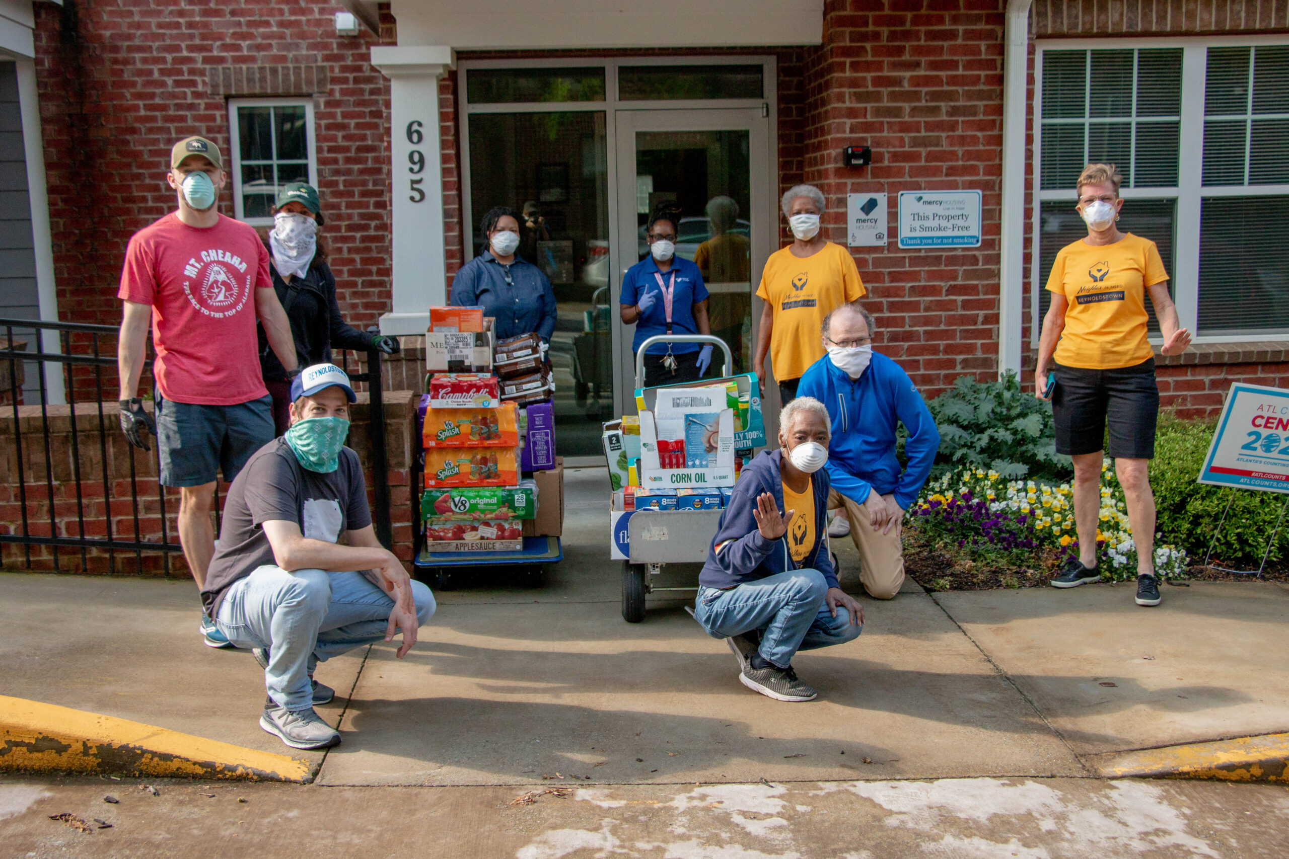 Volunteers pose with donated goods