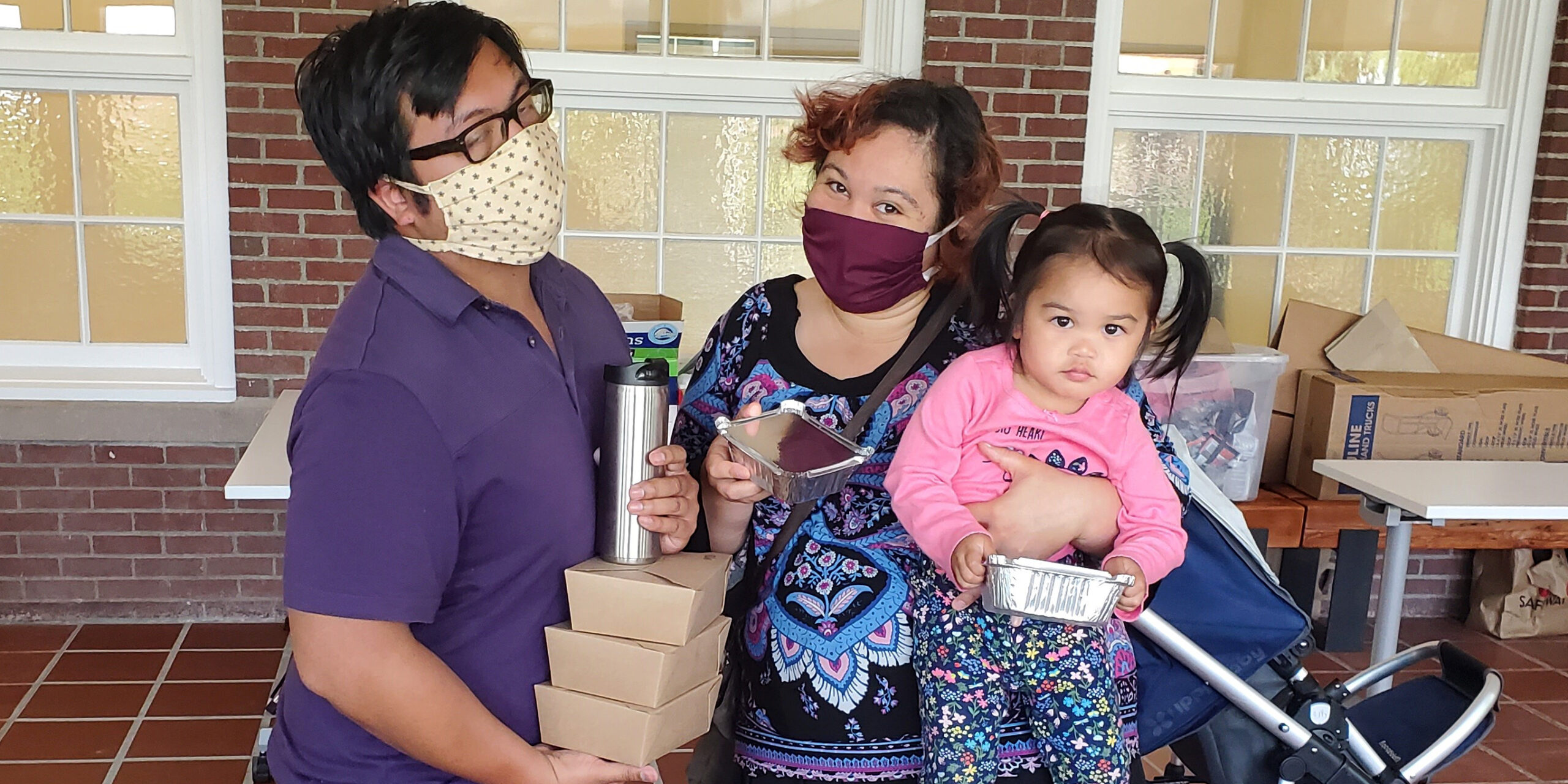 Family receiving meal delivery from Mercy Housing Northwest
