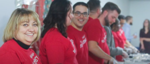 Wells fargo volunteers wearing red shirts