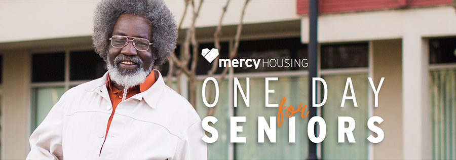 Senior man with afro hairstyle and orange shirt smiling. One Day for Seniors