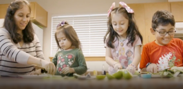 Mercy Housing Resident Emma and her children cooking together